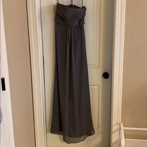 Gray strapless chiffon maxi dress.